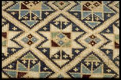 close up of a stars  antique caucasian rug. soft blue and beige colors. Rare. henide@hotmail.com 25 rue la Boétie  75008 Paris