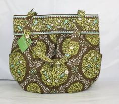 Vera Bradley. Love it but somehow the crafty person in me wants to try to sew my own quilted bag lol.