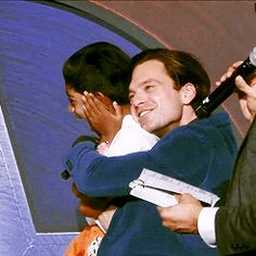 Sebastian Stan hugging a little boy on the Captain America: Civil War Press Tour (Part 3 of 4)