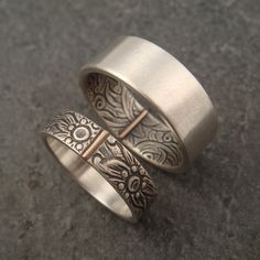 opposites attract I sometimes get an interest in my wedding bands where one half of the couple really likes the floral pattern and the other wants something more subtle. And although I have several non-floral styles of wedding bands, most couples don't seem to want to have rings that do not match. So this is a solution to that problem. If the future groom does not want a flowery wedding band he can have what is, to outward appearances, a plain band that matches her band on the inside.