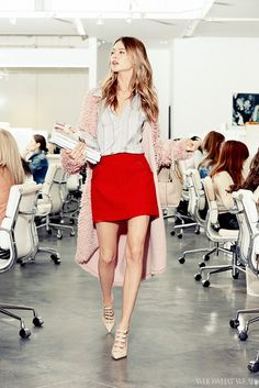 Behati Prinsloo visits the Who What Wear office in a DKNY blush wool oversized coat, Coach skirt, and heels.