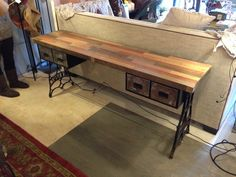 sofa table by rogue decor co. reclaimed oak flooring top, sewing machine legs, and vintage file cabinet drawers. www.facebook.com/rogue.decor