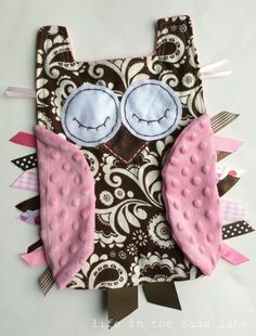 "Owl tag blanket!  Flannel on the front and Minky on the back/wings.  Measures 15""H x 12""W"