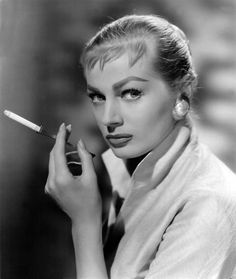 1950s. Actress Anita Ekberg, with a cigarette holder