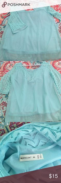 Sheer blouse with chevron lace sleeves Super cute top! Brand new never worn! Light blue color Tops Blouses