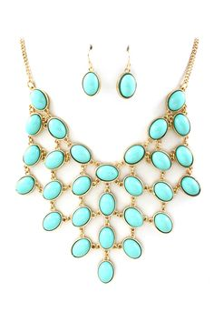 bib necklace in turquoise. With a tan and a white dress?