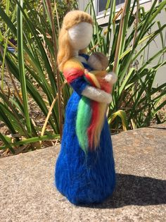 Needle felted mommy with rainbow ring sling