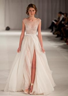 whimsical wedding gown | English (US)... The slit would have to be a little more appropriate. But I love it otherwise