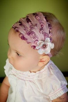 I swore is never put an enormous bow on my kids head but my goodness this is so adorable!!