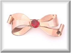 "Signed Coro Sterling retro bow brooch with a faceted red oval rhinestone center. This lovely rose gold sterling pin measures 3"" x 1 1/4"". $38.00. Free shipping in the US. Questions? PM me via FB. PayPal Only."