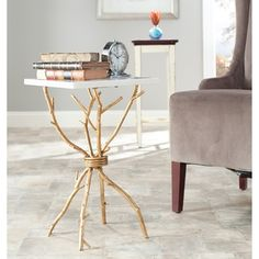 @Overstock - Add style to any room with this artistic metal accent table. Made out of durable white-granite top and a brass frame, it fits well with any decor. This table measures 22high x 14 wide x 14 deep and features legs that resemble tree branches.http://www.overstock.com/Home-Garden/Hidden-Treasures-White-Granite-Brass-Accent-Table/6811738/product.html?CID=214117 $330.99