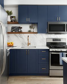 tiles Dark Cabinets To complete the kitchen, we chose quartz countertops and carried a matching large-format porcelain tile up the backsplash to mimic the look of continued countertops for a fraction of the cost! Kitchen Room Design, Modern Kitchen Design, Home Decor Kitchen, Interior Design Kitchen, Kitchen Living, Kitchen Furniture, New Kitchen, Kitchen Tiles, Cuisines Design