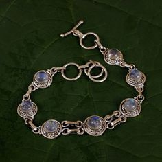 This hand crafted rainbow moonstone bracelet is a sure add-on to your grace and elegance. Rainbow moonstone relates to the sacral chakra, crown and third eye chakra. This bracelet holds a total of 17.5 carats of rainbow moonstone.<br /> [$84.00]