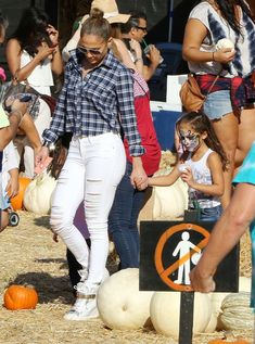 Jennifer Lopez in ripped white denim and plaid.