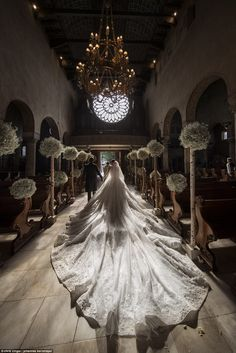 The bride's show-stopping dress came with an eight-metre veil and train and she teamed the...