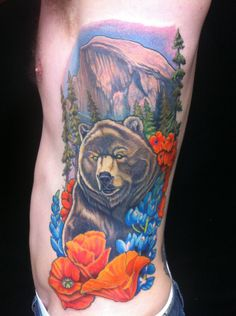 Realistic California tribute tattoo with Yosemite, grizzly bear, and poppies by Champ at Guru Tattoo; San Diego, CA.