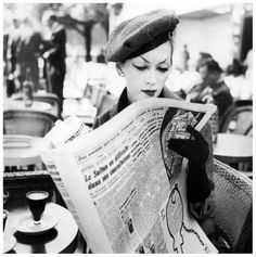 Dovima wearing an ensemble by Dior, Paris, August 1955. Photo by Richard Avedon.