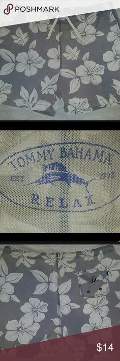 Tommy Bahama - Large Floral Linned Swim Trunks Tommy Bahama  Relax  Floral Pocketed Linned Pullstring  Swimming Trunks   Pre-owned - Used  Minimal Wear - Small Stain   Gray  Men's Size Large  Nylon, Polyester  Made in China   Fast Shipping and Handling! Tommy Bahama Swim Swim Trunks