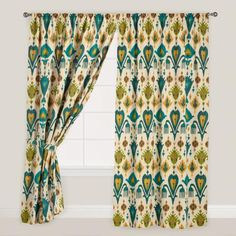 Inspired by the beauty and colors of Scotland, our exclusive Gold and Teal Ikat Aberdeen Cotton Curtains create a focal point with a bold ikat print. Featuring a vibrant blend of teal, green and gold, this fully lined curtain has a sleeve top for a casual, nicely tailored look for any space.