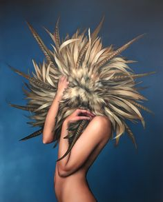 London-based artist Amy Judd creates paintings that feature female figures with flowers, feathers and birds. Artist Amy Judd is represented by Hicks Gallery