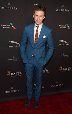 He uses each red carpet to push the envelope. | OK, But Eddie Redmayne Is This Awards Season's Best-Dressed Babe