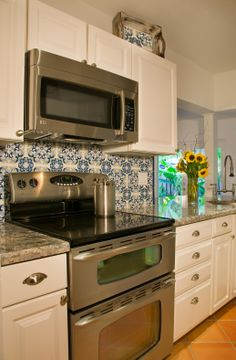 I Love The Blue And White Hand Painted Tile To Pop Against The White  Cabinets.