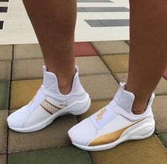 White, gold, pumas shoes