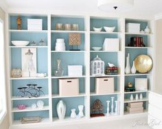 Instead of just stacking several shelves against a wall, this blogger molded four BILLY bookcases together, then painted the backs a light blue to make the pieces look like they were always one. See more at Just a Girl »