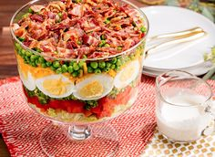 Toss together the pretty, layered ingredients just before serving. Get the recipe from Delish.