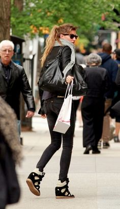 Gisele in Isabel Marant sneakers.