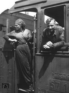 """A Russian female forced laborer serves as the stoker in this German Railway locomotive and is pictured with a German """"co-worker."""" As the war manpower shortages became more severe, slave labor was deployed in many sectors of the civilian economy, including trasnportation."""