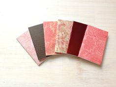 100 ct for $85  custom colors  -   Notebooks: Small Notebooks, Tiny Journals, Mini Wedding Favors, Pink, Red, Favors, Mini Journals, Small, Unique via Etsy