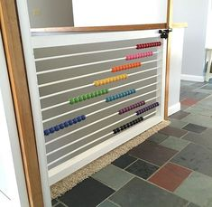 I would add a center brace to this abacus child gate, especially if using wooden dowel rods! Cute concept!