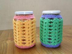 Frascos de 12cm con funda tejida al crochet x 2, $140 en http://ofeliafeliz.com.ar