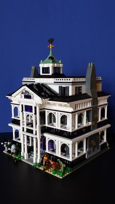 https://flic.kr/p/ENvSzE | Haunted Mansion Side | Disneyland's Haunted Mansion with Hitchhiking Ghosts and Caretaker & dog.