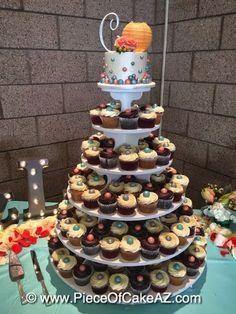 Fun wedding cupcake display!