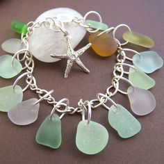 Genuine surf tumbled sea glass with sterling silver. Amazing charm bracelet for the beach lover!  Stone Street Studio