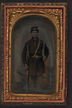 (c. 1861-1865) Soldier in Union frock coat and forage cap with saber and musket