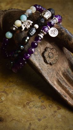 Elephant bracelet stack set of three  with Om charms, amethyst, buddha beads and black pearls by ThePillowBook