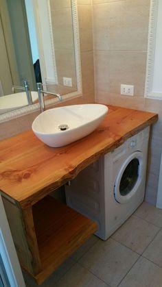 Lavello in legno massello grezo.