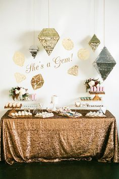 """Inspired by This """"This """"She's a Gem"""" theme takes the cake for creativity and glitzy decor! JL Designs designed this awesome #party #onIBTtoday for her daughter's first #birthday! We spy lots of Sweet & Saucy Shop goodies and gem shaped Studio Mucci pinatas! (Photo by aaron young photography, linens by La Tavola Fine Linen) http://www.inspiredbythis.com/?p=91824"""""""