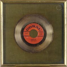 A Buddy Holly gold record: sold for over $11,000.