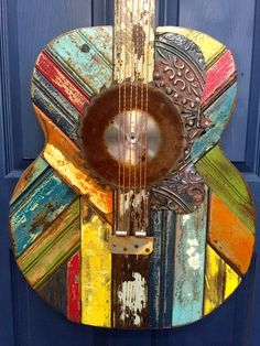 Celebrate your love of all things acoustic with this Gibson Vintage Guitar wall sculpture. It is handcrafted in the Southeast US with reclaimed wood and found objects. The piece is shown in the under the sun colorway. Acoustic Wall, Acoustic Guitars, Guitar Wall Art, Guitar Painting, Music Wall, Reclaimed Wood Art, Found Object Art, Pallet Art, Pallet Wood