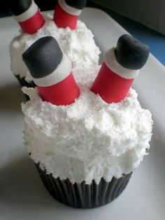 Could be made with pretzel rods dips in red candy melts, white frosting cuffs and black jelly bean boots...
