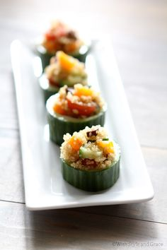 appetizer - quinoa stuffed cucumber..1 cup quinoa, uncooked  2 zucchini, quartered  3 bell peppers (red, yellow, orange), bite size  1 cup cherry tomatoes, halved  1/2 cup  (3.8 oz.) black (or green) olives, sliced  4 Tbsp olive oil  1 tsp garlic powder  salt + pepper.