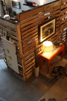 Finally a pallet room divider I like.  Soft lighting is a must. This page ALSO has a pallet coffee table that would be great for board games...