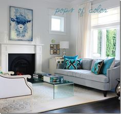 Beautiful grays and blues in this traditional, contemporary with a splash of modern living room.