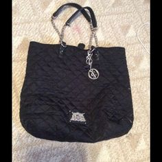 Large Black Juicy Couture Tote Totes interior is perfect condition, and has a zipper pocket with two small pockets. Unfortunately, it has a noticeable stain on the left side so price goes according to condition. Has a magnet closure. Juicy Couture Bags Totes