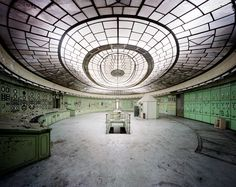 vincent j. stoker photographs abandoned spaces found around the world — an unlikely mixture of control centers, theaters, bath houses, and spots we can't place...