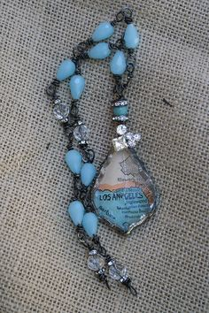 California Dreamin  - interesting - appears to have a map glued to the back of a large crystal pendant - nice matching bead rope, too